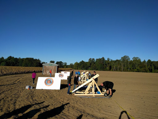 targets and trebuchet in field